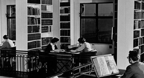 1950s image of people wearing suits in Wellcome Trusts Gallery Library