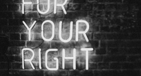 A neon sign saying 'fight for your right'
