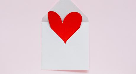 Open envelope with heart coming out